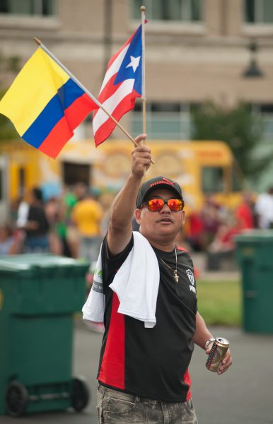 A man waves Colombian