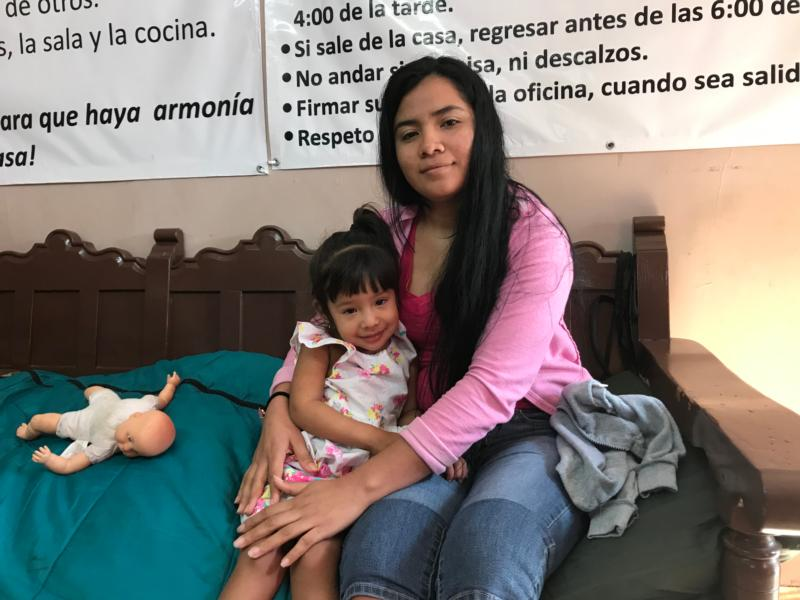 Denia Garcia poses with her daughter Diana, 2, Feb. 6, 2019, at the Catholic-run Dignified Migrant shelter in Piedras Negras, Mexico. Garcia wants to apply for asylum in the United States, but faces a weeks-long wait. The Dignified Border shelter is also short on space to host asylum-seekers for long-term stays. (CNS photo/David Agren) See MEXICO-BORDER-SHELTERS-STRAIN Feb. 11, 2019.