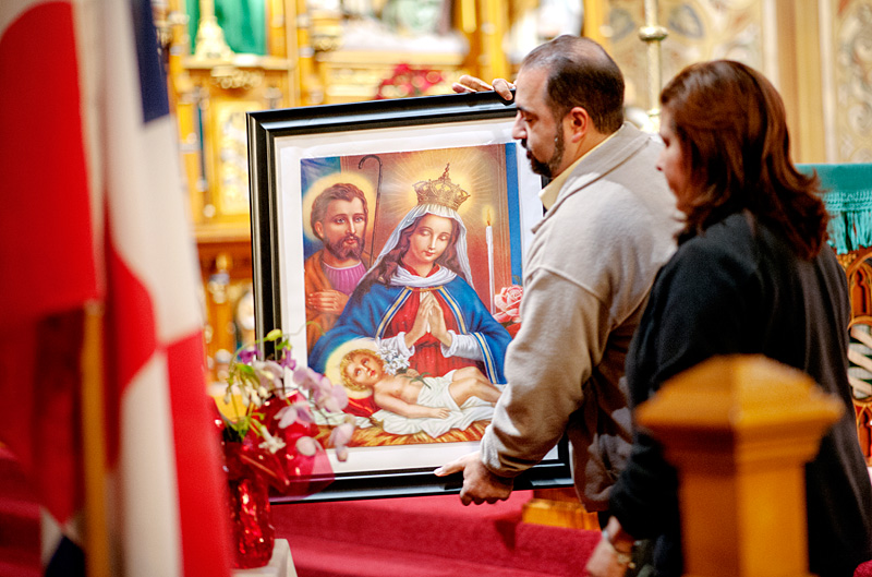 People carry image of Mary.