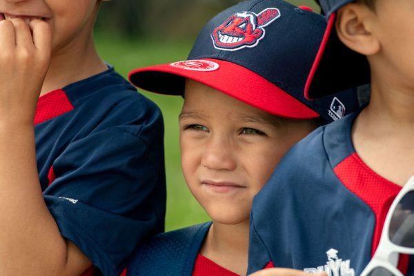 Boy wearing baseball ah
