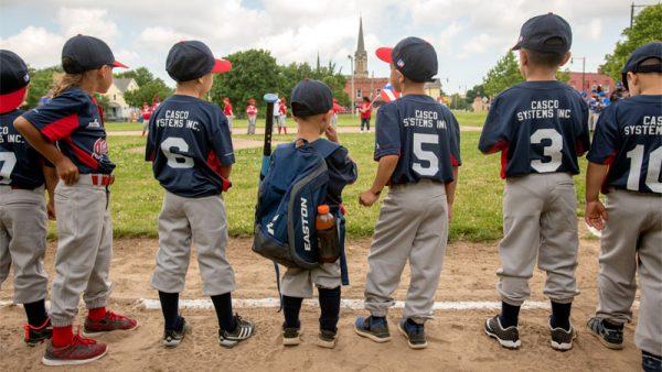 Kids line up for baseball