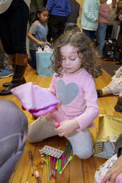 Girl opens gift.