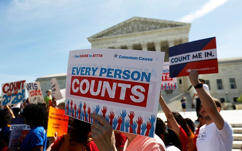 """Demonstrators gather outside the U.S. Supreme Court in Washington April 23, 2019, following oral arguments on a citizenship question for the census. A federal court ruled Sept. 10, 2020, that excluding immigrants in the country illegally from the census count would violate the 14th Amendment, which requires the number of House seats each state is allotted to be based on """"counting the whole number of persons in each state."""" (CNS photo/Shannon Stapleton/Reuters)"""