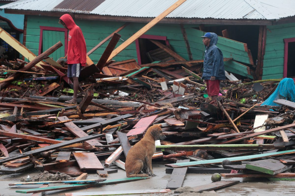 Residents stand amid debris outside homes in Puerto Cabezas, Nicaragua, Nov. 17, 2020, in the aftermath of Hurricane Iota. The Category 4 storm hit the coast of Nicaragua near the border of Honduras Nov. 16, causing storm surges and flooding and further damaging buildings already wrecked by Hurricane Eta. (CNS photo by Oswaldo Rivas/Reuters)