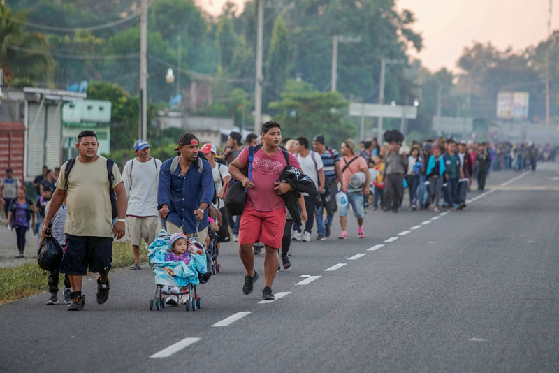 Part of a caravan of Central American migrants walk along a road in Ciudad Hidalgo, Mexico, Jan. 18, 2019, on their journey toward the United States. (CNS photo/Alexandre Meneghini, Reuters) See MEXICO-CARAVAN-VISAS Jan. 28, 2019.
