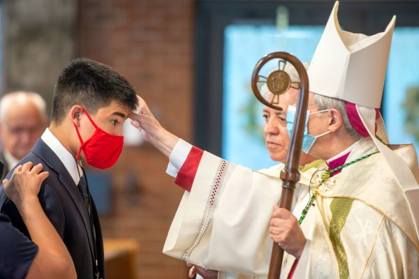 Bishop Salvatore R. Matano blesses Derrick Morales during the confirmation.
